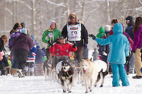 Sonny Lindner along the trail with spectators during the  Ceremonial Start of Iditarod 2012 in Anchorage, Alaska.