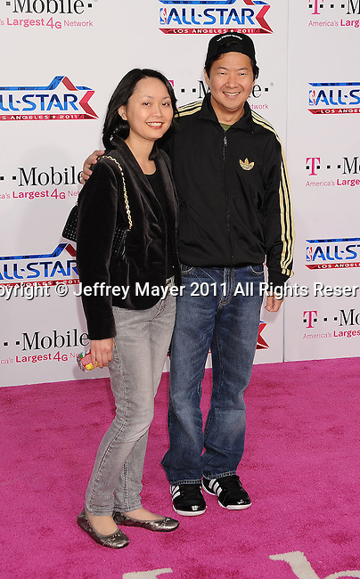 LOS ANGELES, CA - FEBRUARY 20: Ken Jeong and wife Tran Ho  arrive at the T-Mobile Magenta Carpet at the 2011 NBA All-Star Game at L.A. Live on February 20, 2011 in Los Angeles, California.