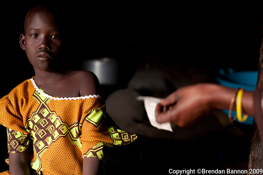 Joyce Laker  an HIV postive child from Madi Opei, Uganda showing her medications. Joyce receives ARV medication from MSF.