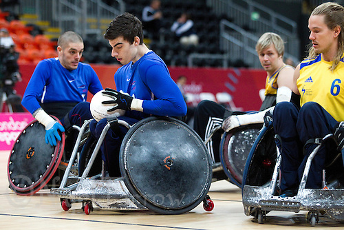 18 APR 2012 - LONDON, GBR - Great Britain's David Anthony (GBR) (Cat. 2.5)(second from left) scores during the London International Invitational Wheelchair Rugby Tournament match against Sweden at the Olympic Park Basketball Arena in Stratford, London, Great Britain (PHOTO (C) 2012 NIGEL FARROW)