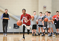 """Aiden Thompson, 10, of Fayetteville runs a basketball drill, Sunday, February 9, 2020 during a basketball tryout at Rogers High School in Rogers. Check out nwaonline.com/200210Daily/ for today's photo gallery.<br /> (NWA Democrat-Gazette/Charlie Kaijo)<br /> <br /> Coach Chad Neipling started a new AAU (Amateur Athletic Union) basketball team called the NWA Devils to provide young basketball players opportunities to build their fundamentals and conditioning in the sport and compete against other AAU teams at a national level. The program gives kids national recognition, tracks player stats and attracts attention from coaches.<br /> <br /> Neipling and other parents wanted additional basketball programs for their kids but found problems in other programs they tried so he started his own. """"Our kids played competitively together. We had been a part of some organizations Where we had to pay a lot of money to get our kids there. Sometimes we'd show up and we didn't have a facility or we went to a tournament and we weren't in the tournament. There wasn't a focus on the fundamentals. A lot of it we felt like was a money grab.""""<br /> <br /> After selecting the players for the team, they will prepare for their first tournament in March. He wants to provide competitive opportunities for the kids but also ensure they grow to be good people. """"We're gonna do some community service. We'll go out and go to the Arkansas food bank,"""" he explained to the kids before starting the tryout. """"I want you to go out in the community and be seen. It's about building great people before a great basketball player."""""""