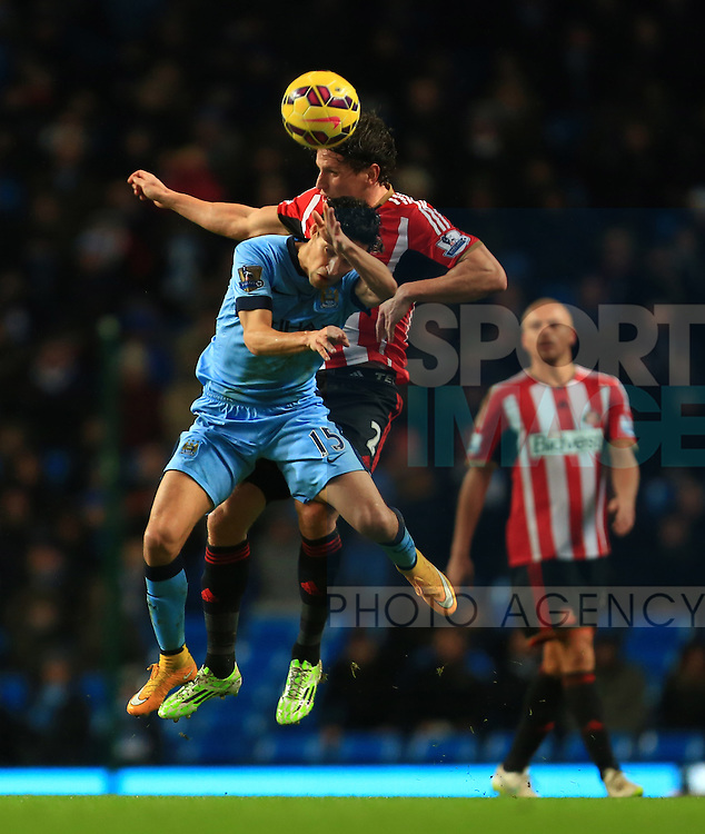 Jesus Navas of Manchester City and Billy Jones of Sunderland contest a header - Manchester City vs. Sunderland - Barclay's Premier League - Etihad Stadium - Manchester - 28/12/2014 Pic Philip Oldham/Sportimage