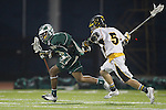 Placentia, CA 05/14/10 - Taylor DeBerry (Foothill # 5) and Tajee Mobley (MC # 25) in action during the Mira Costa vs Foothill boys lacrosse game for the 2010 Los Angeles / Orange County CIF Championship.