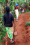 Bora Namutu aged 18yrs and her mother,  returning from the fields to their village in Kaniola area, an area of intense sexual violence against women.  <br />