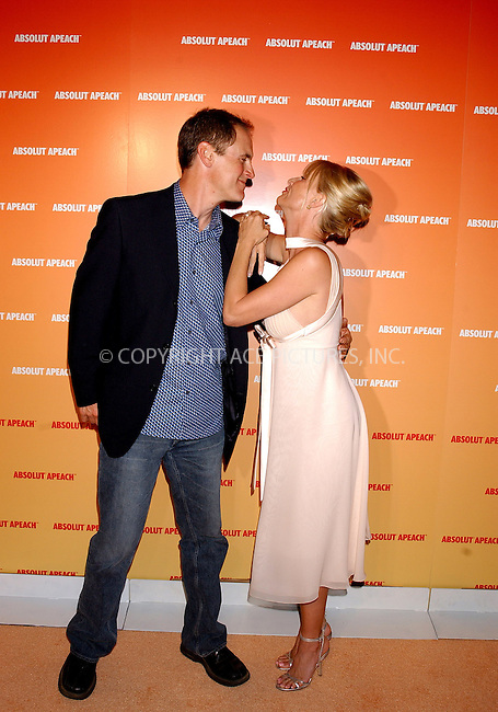 WWW.ACEPIXS.COM . . . . . ....NEW YORK, NEW YORK, MAY 16TH 2005....Mark Moses and Nicollette Sheridan at te Absolut Peach launch at Koi in the Bryant Park Hotel....Please byline: KRISTIN CALLAHAN - ACE PICTURES.. . . . . . ..Ace Pictures, Inc:  ..Craig Ashby (212) 243-8787..e-mail: picturedesk@acepixs.com..web: http://www.acepixs.com