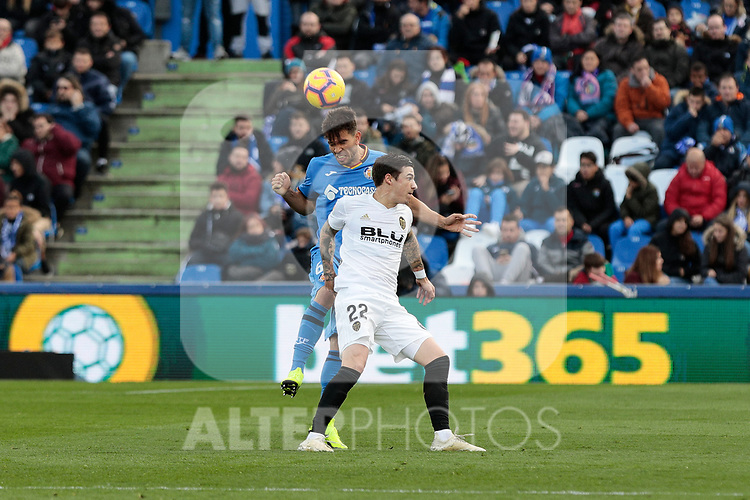 Getafe CF's Leandro Cabrera and Valencia CF's Santi Mina during La Liga match between Getafe CF and Valencia CF at Coliseum Alfonso Perez in Getafe, Spain. November 10, 2018.