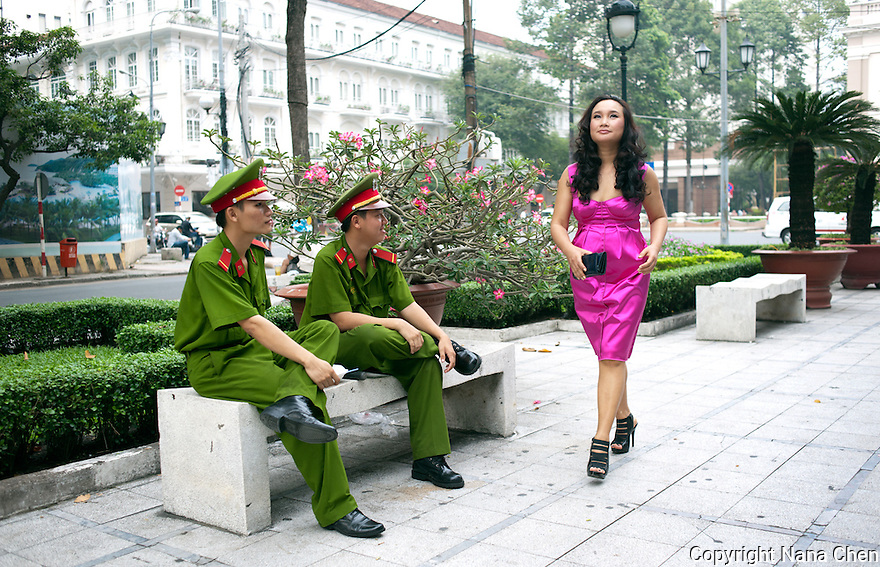 Former boatperson turned home design success, Alan Duong is one of the new generation of super-rich Vietnamese women. Pictured here with local police in D1, the centre of Ho Chi Minh City.