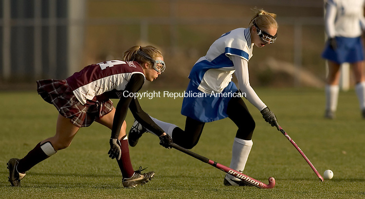 BURLINGTON, CT --08 SEPTEMBER 2007 -110807JS04-Lewis Mills' Molly Tower (2) tries to get pushes Killingly's Stephanie Monstream (24) during their Class S tournament game Thursday at Lewis Mills High School in Burlington. Lewis Mills won the game 4-0.<br />  Jim Shannon/Republican-American