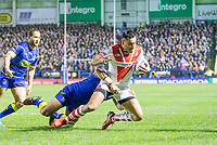 Picture by Allan McKenzie/SWpix.com - 09/03/2018 - Rugby League - Betfred Super League - Warrington Wolves v St Helens - Halliwell Jones Stadium, Warrington, England - St Helens' John Taia is tackled by Warrington.
