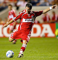 Chicago Fire midfielder Logan Pause (12) prepares to kick the ball.  The Chicago Fire defeated the New England Revolution 2-1 in the quarterfinals of the U.S. Open Cup at Toyota Park in Bridgeview, IL on August 23, 2006...