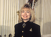 First lady Hillary Rodham Clinton makes remarks in the State Dining Room as she hosts a press event to preview the holiday decorations at the White House in Washington, D.C. on December 5, 1994.<br /> Credit: Ron Sachs / CNP