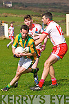 Lispole Sean Dorgan in possession of the ball tackled by An Ghaeltacht Aodhan MacGearailt and Eanna Ó Conchúir during the CFL Div. 3 match at Lispole GAA Grounds on Sunday afternoon.
