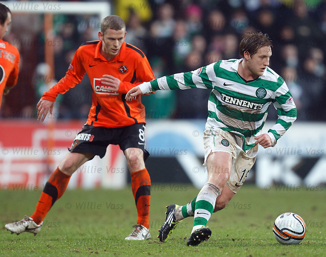 Kris Commons gets away from Scott Robertson