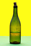 old dust covered wine bottle with liquid content object on yellow green background