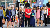 14h April 2018, Aintree Racecourse, Liverpool, England; The 2018 Grand National horse racing festival sponsored by Randox Health, day 3; Racegoers get pictured with the bandsman