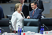 "Enrique Pena Nieto, Mexico's president, right, talks to Michelle Bachelet, Chile's president, during an opening plenary entitled ""National Actions to Enhance Nuclear Security"" at the Nuclear Security Summit in Washington, D.C., U.S., on Friday, April 1, 2016. After a spate of terrorist attacks from Europe to Africa, U.S. President Barack Obama is rallying international support during the summit for an effort to keep Islamic State and similar groups from obtaining nuclear material and other weapons of mass destruction. <br /> Credit: Andrew Harrer / Pool via CNP"