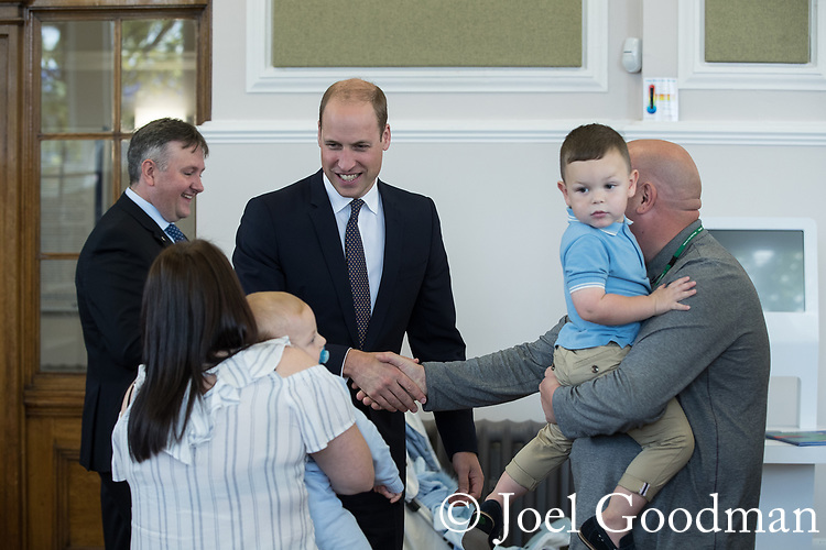 © Joel Goodman - 07973 332324 - all rights reserved . NO ONWARD SALE OR SYNDICATION PERMITTED - ONLY FOR USE IN REPORTING THE LIVE STORY TO WHICH THE PHOTOGRAPH IS RELATED . 14/09/2017 . Liverpool , UK . The Duke of Cambridge , Prince William , meets families during a visit to Life Rooms in Walton . Life Rooms provides community support to help people recover from mental health issues . Photo credit : Joel Goodman