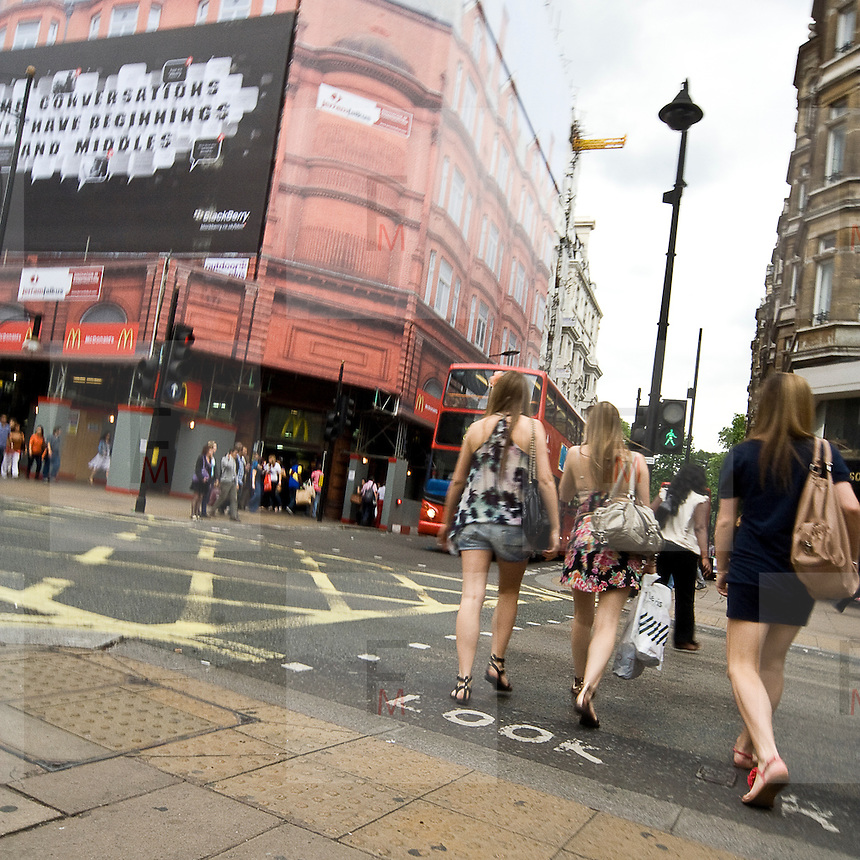People walk along Oxford Street, a major thoroughfare in London. With its 548 shops it is Europe's busiest shopping street.