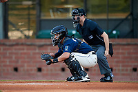 Mobile BayBears catcher Francisco Arcia (32) and home plate umpire Lewis Williams during a game against the Pensacola Blue Wahoos on April 25, 2017 at Hank Aaron Stadium in Mobile, Alabama.  Mobile defeated Pensacola 3-0.  (Mike Janes/Four Seam Images)