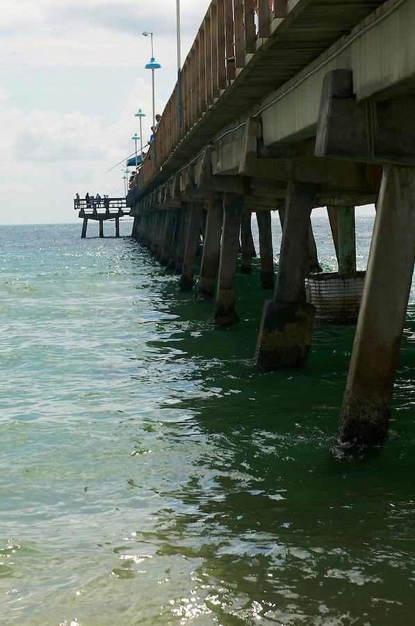 People fishing in Lauderdale by the Sea Pier, in Fort Lauderdale, Florida.