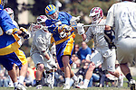 Los Angeles, CA 04/11/09 -  Ryan Sanders (UCSB#5) rips a shot on goal despite being swarmed by LMU defenders during the UCSB-LMU men's lacrosse game at Leavey Field (Loyola Marymount University).    UCSB defeated LMU 12-9.