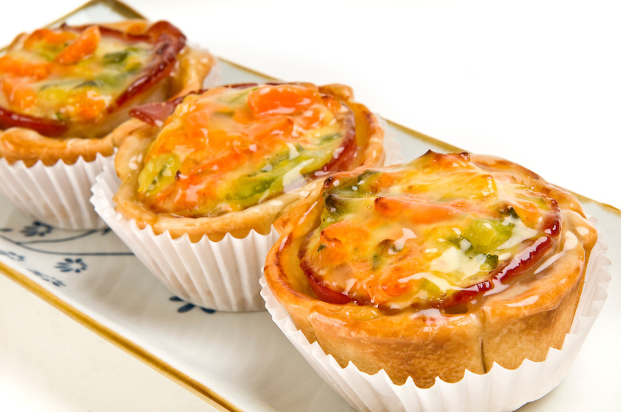 Group of homemade mini quiche of vegetables close up