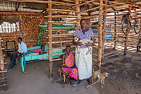 Mary, Goat-Herder, Juba, South Sudan, 2014<br /> Mary Sebit is shown here with her mother, Regina Pont (left), at their home in Juba. They live together with Mary's five children and her policeman husband. They have established their lives in a newly created country riddled by ongoing conflict, and so the women look to support their families through home-based income-generating projects such as sewing and raising animals. BRAC helps Mary raise mature goats that produce babies, which she sells for about $125 each. She uses the money to send her children to school.