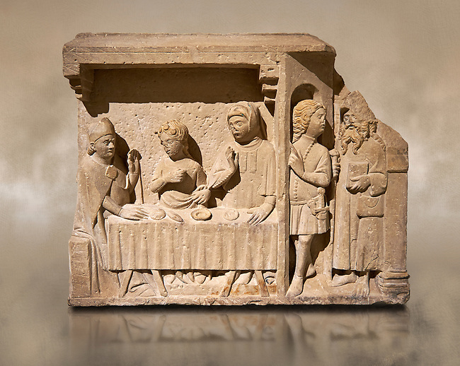 A Gothic stone carving of St. Andrew Bishop bring tempted by the devil. Second half of the fourteenth century by Bartomeu de Robio.From the church of Santa Maria de Castello Farfanya (Noguera). Inv MNAC 122485. National Museum of Catalan Art (MNAC), Barcelona, Spain