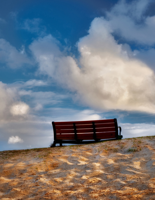 Bench with sunrise clouds. Kailua Beach Park, Oahu, Hawaii