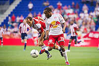 Dane Richards (19) of the New York Red Bulls and Nick LaBrocca (10) of CD Chivas USA. The New York Red Bulls and CD Chivas USA played to a 1-1 tie during a Major League Soccer (MLS) match at Red Bull Arena in Harrison, NJ, on May 23, 2012.