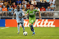 Zach Scott (20) defender Seattle Sounders moves up field..... Sporting Kansas City were defeated 1-2 by Seattle Sounders at LIVESTRONG Sporting Park, Kansas City, Kansas.