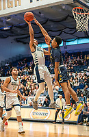WASHINGTON, DC - FEBRUARY 22: Scott Spencer #2 of La Salle blocks a shot by Armel Potter #2 of George Washington during a game between La Salle and George Washington at Charles E Smith Center on February 22, 2020 in Washington, DC.