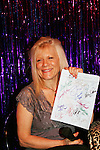 One Life To Live's Ilene Kristen holds OLTL script which was auctioned off on April 28, 2010 at Will Clark's P*rno Bingo at Pieces, New York City, New York to benefit the American Foundation for Suicide Prevention - an event presented by We Love Soaps (Damon Jacobs and Roger Newcomb). (Photos by Sue Coflin/Max Photos)