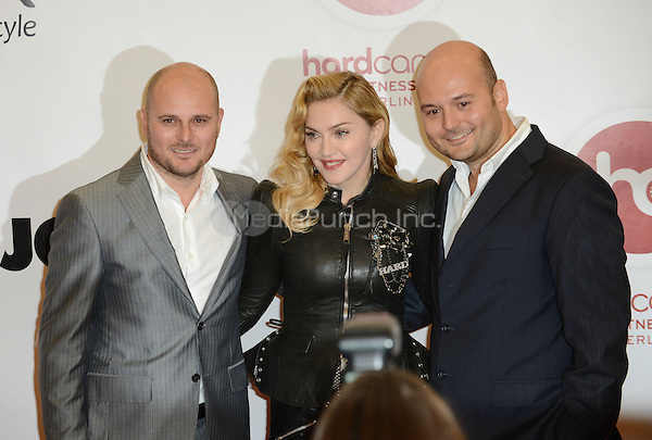 """Madonna and the team members of the  fitness studio attending the """"Hard Candy Fitness"""" event in Berlin, Germany, 17.10.2013. Photo by Janne Tervonen/insight media /MediaPunch Inc. ***FOR USA ONLY***"""
