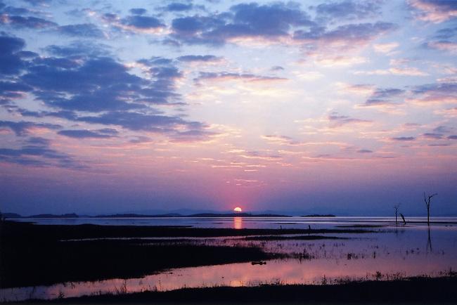 Beautiful, eyecatching sunset with clouds of pinks and blues reflecting on the Zambezi River, Zimbabwe, Africa.