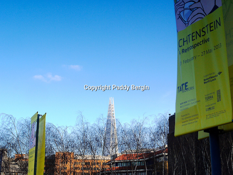 A view through the winter trees of the Shard from outside the Lichtenstein Exhibition at Tate Modern.<br />
