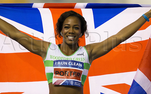 28.02.2016. EIS Sheffield, Sheffield, England. British Indoor Athletics Championships Day Two. Tiffany Porter (Woodford G) holds up a Union Jack after winning the 60m Hurdles British Title.