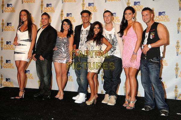 "CAST OF 'JERSEY SHORE': Sammi Giancola (aka. ""Sweetheart""), Ronnie Magro (aka. ""Fist Pump Brah""), Angelina Pivarnick (aka. ""Jolie""), Pauly Del Vecchio, Nicole Polizzi (aka. ""Snooki""), Vinny Guadagnino, Jenni Farley (aka. ""J-Woww"") and Mike Sorrentino (aka. ""The Situation"").MTV Movie Awards 2010 - Press Room held at the Gibson Amphitheatre, Universal City, California, USA..June 6th, 2010.full length mini dress jewel gem encrusted strapless cream white silver sparkly shiny tanned hand on hip gold platform peep toe shoes glittery rings jeans denim black top pink lace .CAP/ADM/BP.©Byron Purvis/AdMedia/Capital Pictures."