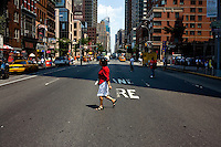 Woman in red crossing New York Street. ..New York City, New York.  Street Photography from Manhattan and Brooklyn.  Subway, Union Square, Metro Stations, New York City Skyline, David Banks, and Bryan Derballa.