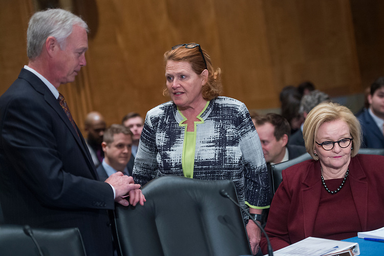 "UNITED STATES - FEBRUARY 07: From left, Chairman Ron Johnson, R-Wis., and Sen. Heidi Heitkamp, D-N.D., and ranking member Sen. Claire McCaskill, D-Mo., conduct a Senate Homeland Security and Governmental Affairs Committee roundtable in Dirksen Building titled ""Reauthorizing DHS: Positioning DHS to Address New and Emerging Threats to the Homeland,"" on February 7, 2018. (Photo By Tom Williams/CQ Roll Call)"