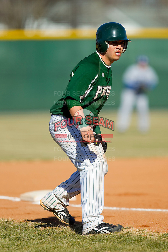 Bobby Amato #2 of the Greensboro College Pride takes his lead off of third base against the Washington & Lee Generals at War Memorial Stadium on February 13, 2011 in Greensboro, North Carolina.  Photo by Brian Westerholt / Four Seam Images