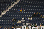 A sparse and cold Nevada crowd watches the end of an NCAA college football game against Hawaii in Reno, Nev. Saturday, Sept. 28, 2019. (AP Photo/Tom R. Smedes)