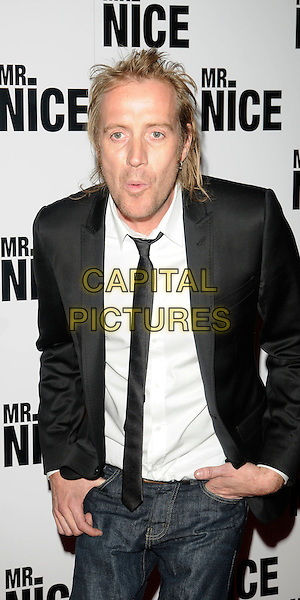 "RHYS IFANS .Attending the ""Mr. Nice"" UK Film Premiere, Cineworld cinema, Haymarket, London, England, UK, October 4th 2010..half length black suit jacket tie white shirt jeans hand in pocket mouth funny .CAP/CAN.©Can Nguyen/Capital Pictures."