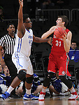 SIOUX FALLS, SD - MARCH 5:  Brent Calhoun#45 of Fort Wayne defends passer Dan Jech #31 of South Dakota in the 2016 Summit League Tournament.  (Photo by Dick Carlson/Inertia)