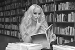 CORAL GABLES, FL - APRIL 10: (EDITORS NOTE: Image has been converted to black and white) Gigi Gorgeous poses for portrait after a Q&A and book signing to Promotes Her New Book 'He Said, She Said: Lessons, Stories, and Mistakes from My Transgender Journey' at Books and Books on April 10, 2019 in Coral Gables, Florida.  ( Photo by Johnny Louis / jlnphotography.com )