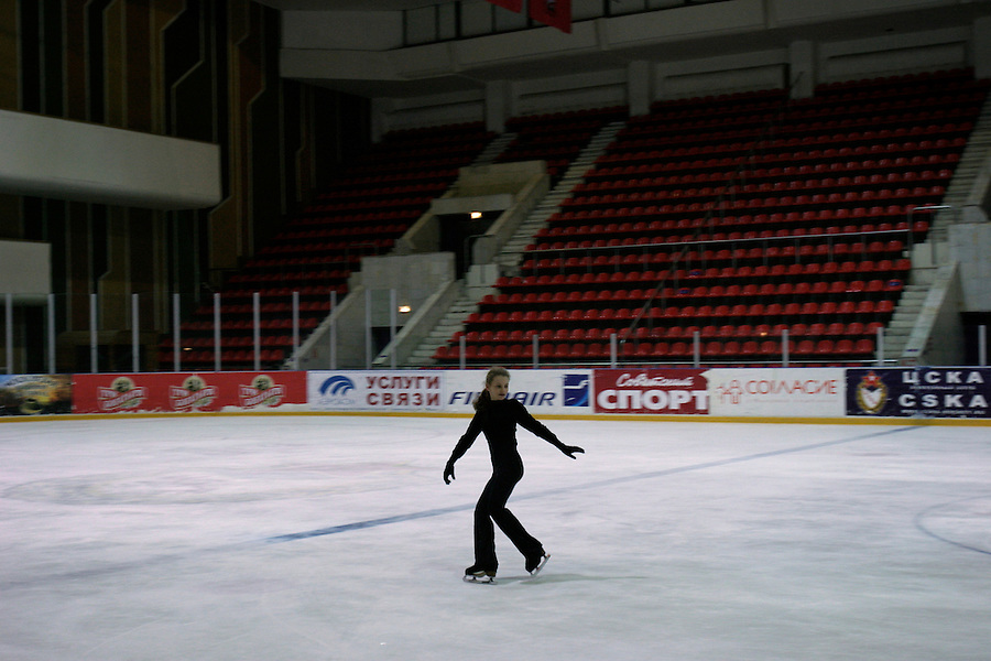 Moscow, Russia, 23/02/2004..Young skaters being trained by chief coach Svetlana Sukolovskaya on the main rink at the TsKA [Central Red Army] club. Veronika Kropotina skates alone at the end of the training session...