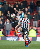 Max Muller of Wycombe Wanderers & Calum Dyson of Grimsby Town during the Sky Bet League 2 match between Grimsby Town and Wycombe Wanderers at Blundell Park, Cleethorpes, England on 4 March 2017. Photo by Andy Rowland / PRiME Media Images.