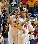 Ohio State University guard Evan Turner (21) is congratulated by teammates David Lighty and Jon Diebler after sinking a 37-foot shot at the buzzer to give the Buckeyes a 69-68 victory over the University of Michigan in a quarterfinal game in the 2010 Big Ten Men's Basketball Tournament at Conseco Fieldhouse in Indianapolis, IN on March 12, 2010.  Ohio State went on to win the tournament by defeating the University of Minnesota in the championship game two days later.  (Photo by Bob Campbell)