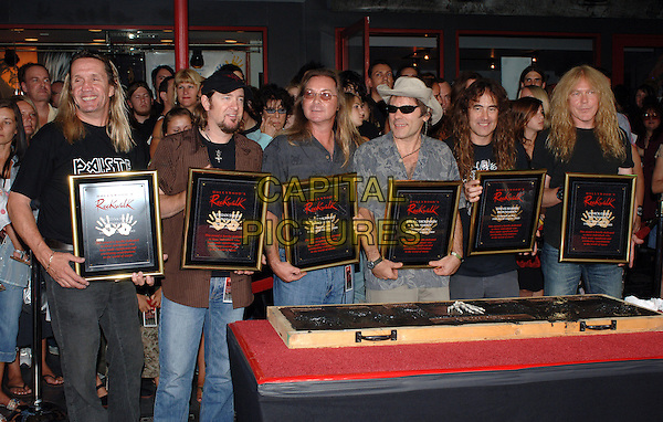 IRON MAIDEN .Getting Inducted Into The Hollywood Rockwalk at The Guitar Center, Los Angeles, California..After The Event Fans Went Completely Crazy & A Near Riot Ensued. Twenty Police Vehicles & Dozens of Officers Attended The Scene To Calm The Crowd...August 19th, 2005.half length band group plaque.www.capitalpictures.com.sales@capitalpictures.com.© Capital Pictures.