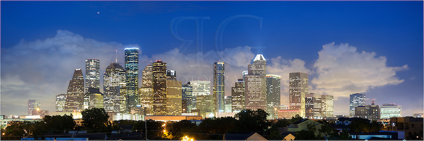 The city lights of downtown Houston lit up the belly of ominous storm clouds as I was shooting for a company just outside of the highrises. This skyline panorama is several photos stitched together and looks east. Houston is one of the most populated areas in the United States, housing more than 2 million people, so while I was shooting from this vantage point, I appreciated being above all the traffic and noise.<br />